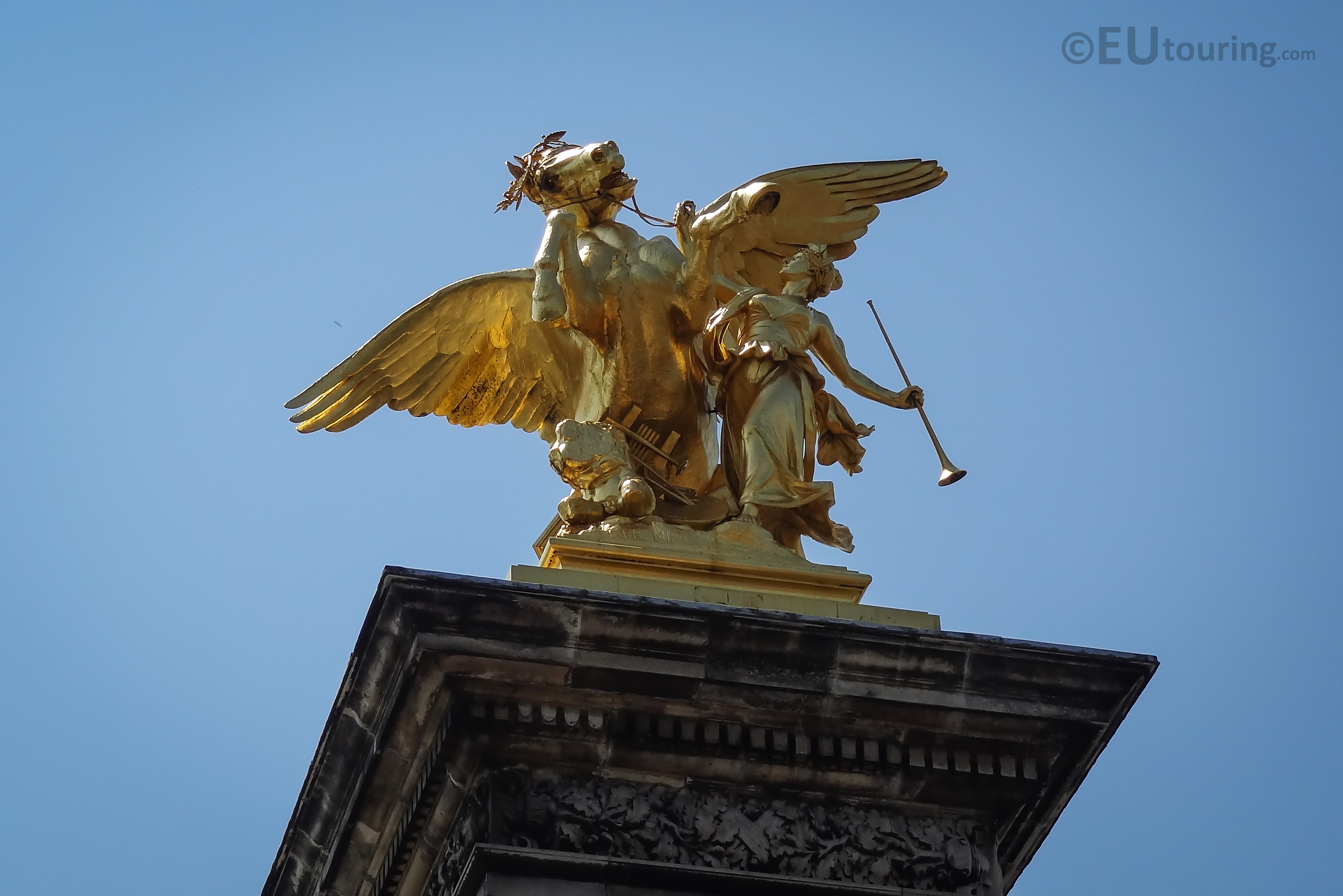 Golden Pegasus and Fame statue