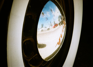 Ocean Drive reflected in a Nash hubcap