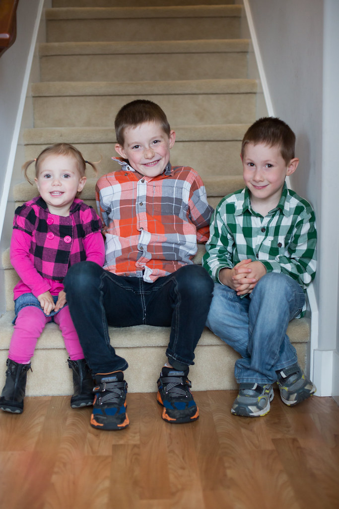 Siblings sitting on the stairs