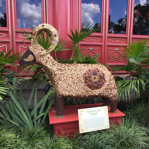 69:365 Year of the Sheep at Epcot Flower & Garden Festival. According to the sign, good careers for people born in the year of the sheep include actor, gardener, or beachcombers.