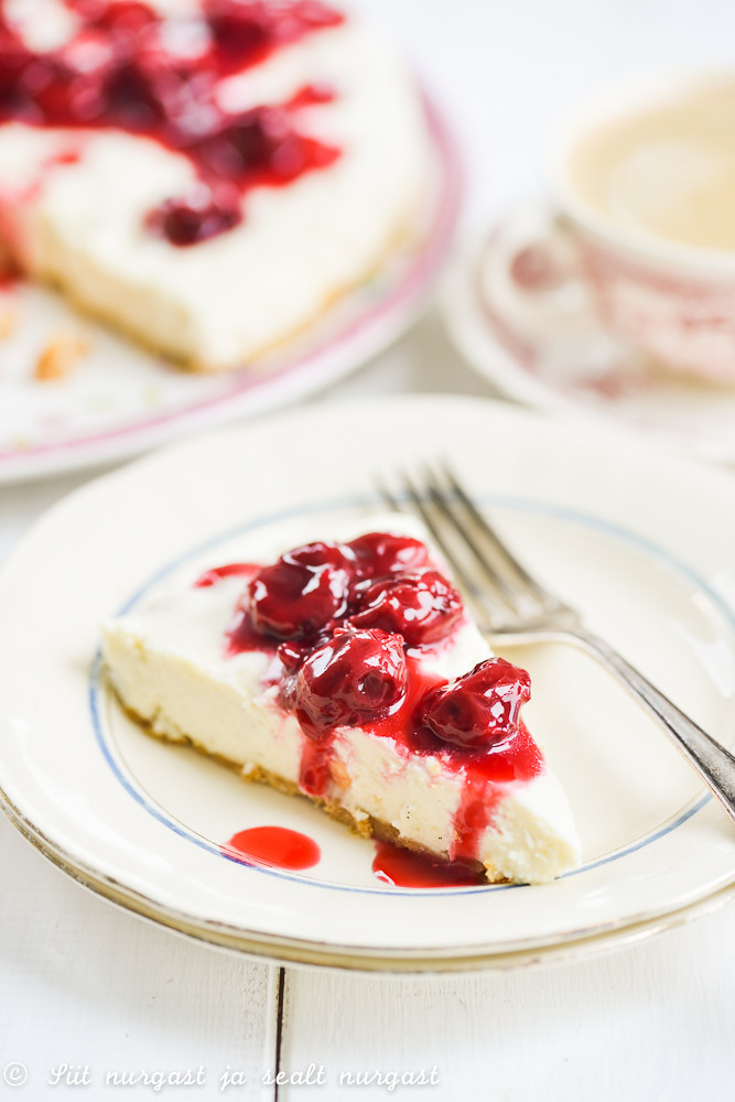white chocolate cheesecake with cherry compote
