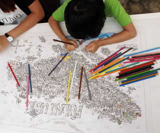 Colouring the Pulau Ubin Fun Map at Uncle Lim's shop