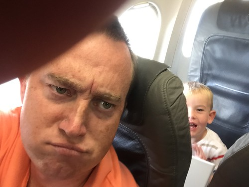 What luck! A tray table kicking kid behind me!