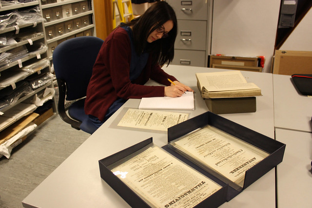 A researcher studying 19th century playbills at ROH Collections