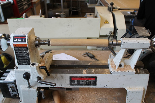 Wood spindle mounted on lathe