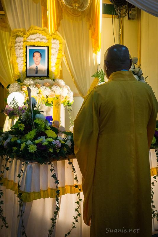 Monk praying at Grandfather's funeral