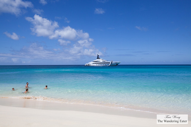 Private yacht with a water slide and children playing in the water