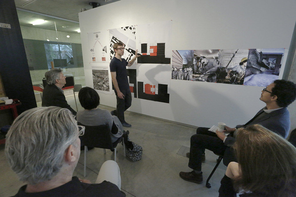 Jared Curtis presenting his work in the College of  Architecture, Art, and Planning's Bibliowicz Family Gallery.