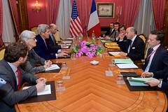 U.S. Secretary of State John Kerry - flanked by Under Secretary of State for Political Affairs Wendy Sherman, Chief of Staff Jon Finer, and National Security Council Senior Director for Iran, Iraq, Syria and the Gulf States Robert Malley, sits across from French Foreign Minister Laurent Fabius and his advisers on March 25, 2015, in Lausanne, Switzerland, as the P5+1 allies discuss negotiations about the future of Iran's nuclear program. [State Department Photo / Public Domain]