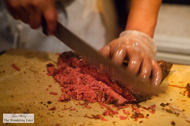 Chopping smoked pastrami by John Brown Smokehouse