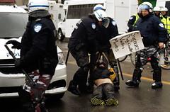 Protester under arrest