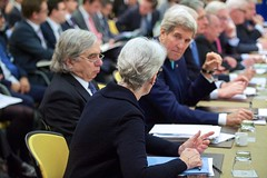 U.S. Under Secretary of State for Political Affairs speaks with U.S. Secretary of State John Kerry and U.S. Energy Secretary Dr. Ernest Moniz on March 31, 2015, in Lausanne, Switzerland, before they join their counterparts from Germany, China, the European Union, France, the United Kingdom, and Russia in direct negotiations with Iranian officials about the future of their country's nuclear program. [State Department photo/ Public Domain]