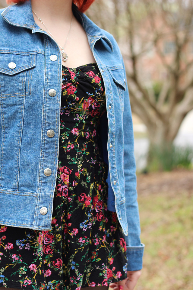 Detail Shot of Floral Print Romper and Jean Jacket Outfit