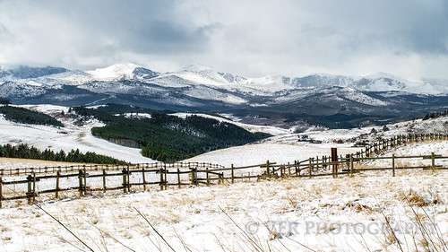 wood travel mountain snow mountains tourism fence landscape landscapes wooden spring buffalo snowy scenic fences peak rail fencing wyoming peaks sights snowscape wy snows bighornmountains usdepartmentofagriculture usforestservice johnsoncounty us16 bighornnationalforest powderriverpass ushighway16