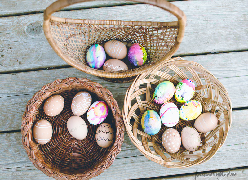 Baskets of coloured eggs for Easter