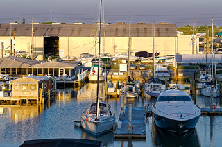 Sunset's back lighting over sailboat and yacht docked at Maximo Marina, St. Petersburg, Florida. 7:28 PM