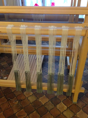 Pre-weighting the pattern heddles