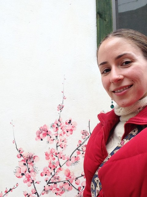 Posing with a pretty mural on a hanok