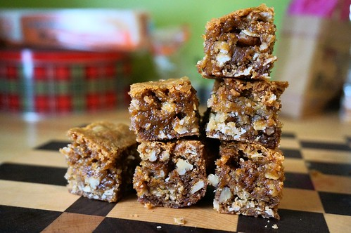 Chewy caramel swirl pecan bars, stacked like a bar graph