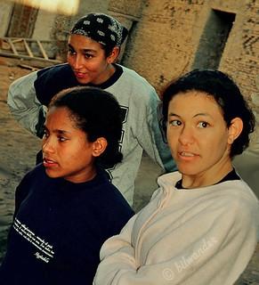 Tunisia,   Sahara desert,  teen girls  in the oasis of Tozer