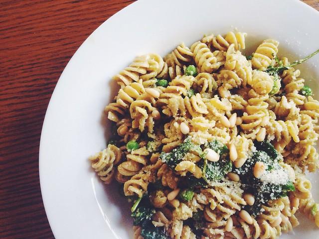 pesto pasta with peas, parmesan, and pine nuts