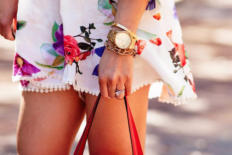 cute & little blog | petite fashion | choies floral romper, arm party, stella & dot christina link bracelet, cartier love bracelet screw bangle | spring outfit
