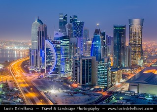 Qatar - Doha - New modern city skyline with illuminated skyscrapers at Dawn