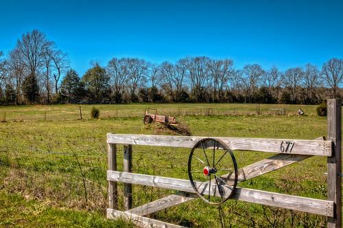 wheel march spring gate unitedstates farm tennessee sunny bluesky pasture lewisburg manurespreader