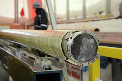 A close-up of an ice core still in the drill barrel