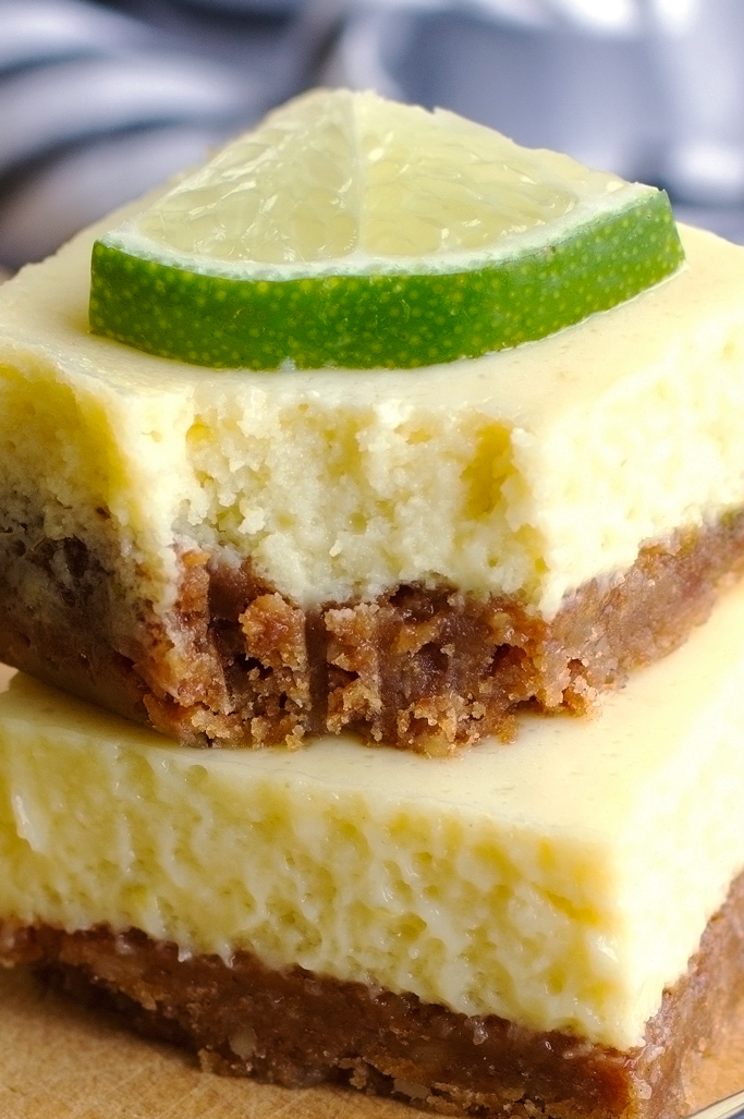 close up of stack of key lime pie bars with a bite missing