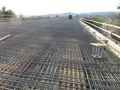 asphalt(0.0), outdoor structure(0.0), roof(0.0), track(0.0), road surface(0.0), walkway(0.0), reinforced concrete(1.0), construction(1.0),
