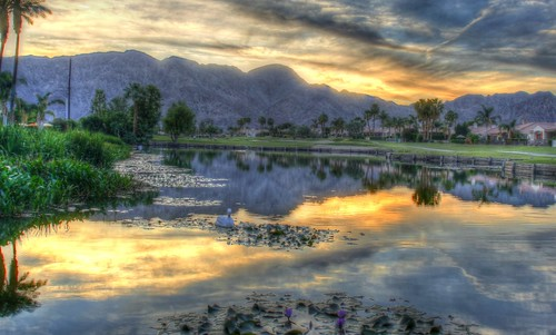 trees sunset sky mountains water golf fire desert coachellavalley greens golfcourse waterfeature pga laquinta waterhazard desertmountains desertclouds petedye laquintaresort pgacom thedunescourse spebak pga365