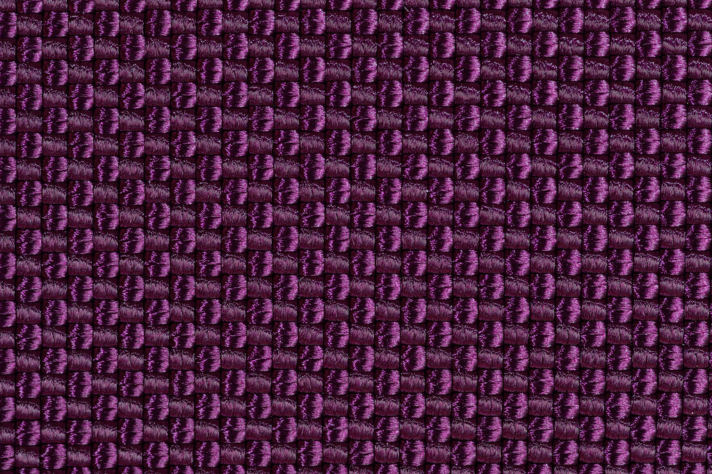 A close-up view of the Aubergine ballistic nylon fabric in the Tom Bihn Aeronaut 45