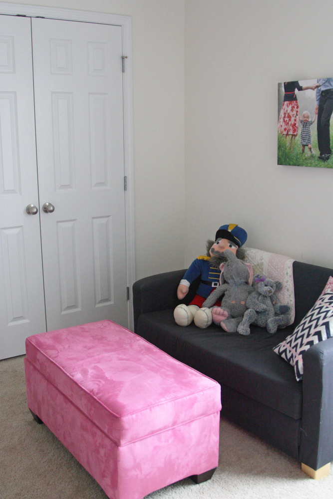 Shared toddler bedroom with room for reading and art projects