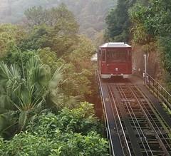 Peak Tram arrives on Victoria's Peak in Hong Kong S.A.R., Hong Kong