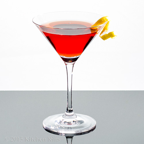 The Rosita Cocktail in cocktail glass with lemon twist garnish
