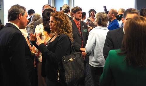 Group of certified green businesses mingling at a networking event.