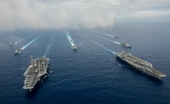 In this file photo, the aircraft carriers USS John C. Stennis (CVN 74) and USS Ronald Reagan (CVN 76) conduct dual aircraft carrier strike group operations in the Philippine Sea in June 2016. (U.S. Navy/MC3 Jake Greenberg)