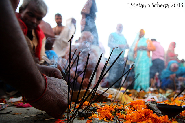 Offering incense sticks to Mother Ganga at Kumbh Mela - Allahabad, India