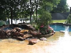 Custom Spa With Stone Waterfall Spillway