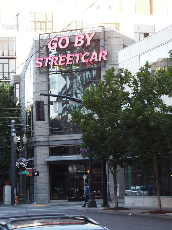 "Go By Streetcar: A parody of the ""Go By Train"" sign at Portland Union Station"