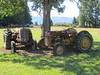 Retired tractors under a tree