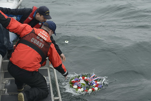 Chris Magavero, a member of Safeboat International and former shipmate of fallen Petty Officer 3rd Class Ronald Gill Jr., and Lt. Ben Crowell, commanding officer of Coast Guard Station Seattle, lay a wreath in honor of Gill near Vashon Island, Wash., March 25, 2015. Magavero served as Gill's lead petty officer at Maritime Safety and Security Team 91111 in Anchorage, Alaska, from 2004 to 2006. (U.S. Coast Guard photo by Petty Officer 3rd Class Amanda Norcross)