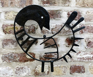 """Iron """"sankofa"""" symbol on a memorial to the enslaved workers who """"helped"""" build the Unitarian Church in Charleston, SC"""
