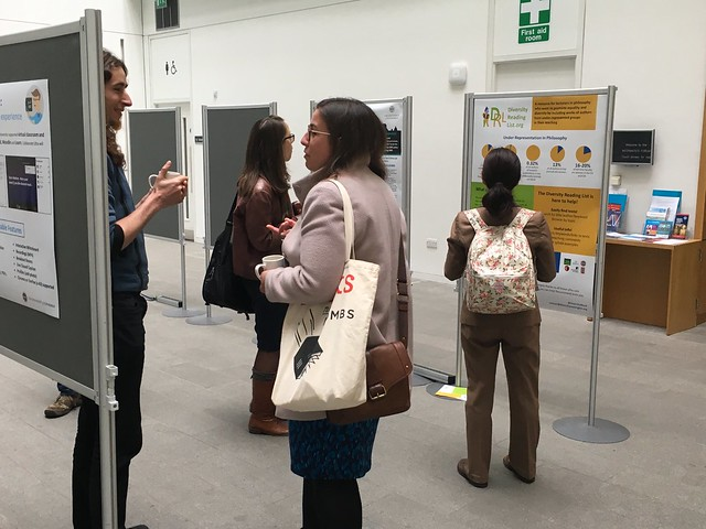 Participants explore posters including Simon Fokt's Diversity Reading List poster at eLearning@ed 2016