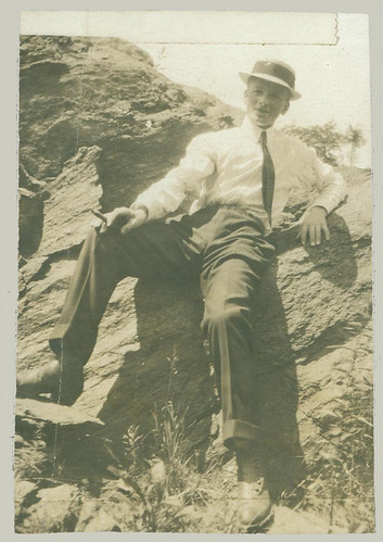 Smoking Man sitting on a Rock