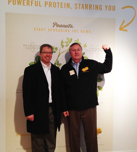 Throughout the week, visitors got a chance to take a picture and show off their #peanutpower. AMS Fruit and Vegetable Program Deputy Administrator Charles Parrott (left) takes a picture with National Peanut Board CEO Bob Parker (right).