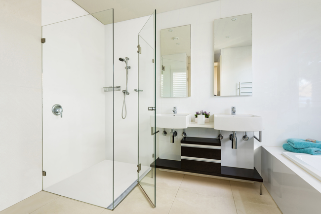 Corian's shower floor has fully integrated linear drainage from Stormtech's Marc Newson line