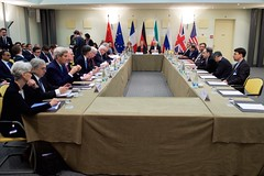 U.S. Secretary of State John Kerry sits with his counterparts from Germany, China, the European Union, France, the United Kingdom, and Russia on March 31, 2015, in Lausanne, Switzerland, before the P5+1 partner nations resume direct negotiations with Iranian officials, top and right, about the future of their country's nuclear program. [State Department photo/ Public Domain]