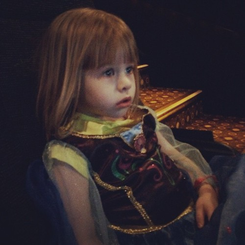 "Daycare is closed, so it's Mommy & Lucy Day. We're waiting for Cinderella to start. But really, she only cares about the ""Frozen Fever"" short before the movie. (""How many more minutes?"" every 10 seconds.)"